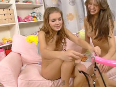 Two crazy hot bull dyke teenies loving each other with dildo