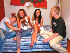 Two guys have groupsex with two amazing cuties on the sofa