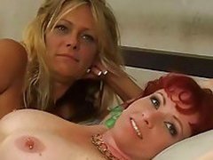 Two lesbian chicks dildoing pussy