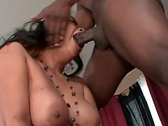 Oriental girl sucks a popular black strapon