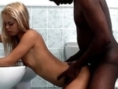 White legal age teenager blond cutie is having interracial sex with black dude in a washroom